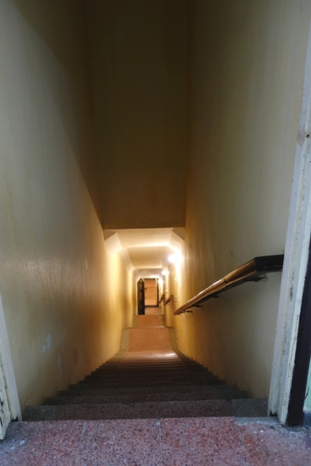 The steep staircase entrance to the underground war bunker at Building D67, Hanoi, Vietnam